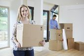 Young Couple Moving Into New Home Together