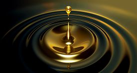picture of drop oil  - An extreme close up of a drop of oil creating ripples on an isolated black background - JPG