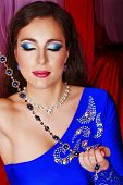 image of harem  - Young oriental beauty holding jewelry - JPG