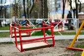 picture of amusement park rides  - Empty red carousel metal seat - JPG