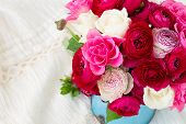 stock photo of bunch roses  - bunch of fresh pink  ranunculus and rose flowers  on white lace background - JPG