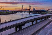 picture of portland oregon  - Portland Oregon view of the Steel Bridge with light reflections on the Willamette River - JPG