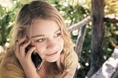 pic of little girls photo-models  - Outdoor portrait of beautiful blond smiling Caucasian teenage girl in a park talking on a cell phone vintage toned photo filter effect - JPG