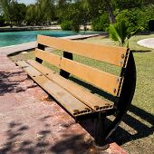 picture of pews  - Wooden bench in park near caribbean lagoon - JPG