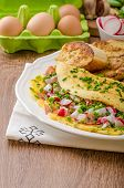 picture of french toast  - Omelette with spring vegetables and bacon fresh peas and radish garlic french toast sprinkled with chive and microgreens - JPG