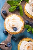stock photo of curd  - Mini lime curd tartlets with meringue - JPG