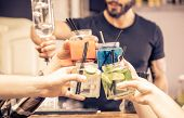stock photo of london night  - toast with coktails glasses - JPG