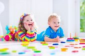 pic of kindergarten  - Kids playing with wooden toys - JPG