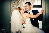 foto of charming  - Wedding dance of charming bride and groom on their wedding celebration in a luxurious restaurant - JPG