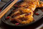picture of chillies  - Delicious Asian sizzling chilli shrimps served in a hot cast iron platter.