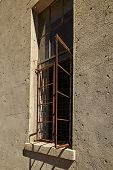 foto of framing a building  - Abandoned building with rusty window frame open - JPG
