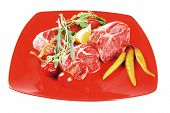 foto of red meat  - fresh raw beef red meat fillet medallion chunks on red plate isolated over white background - JPG