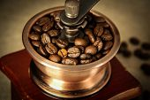 picture of wooden box from coffee mill  - Closeup picture of coffee bean grinder and coffee bean - JPG