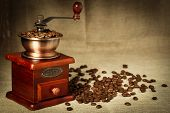 image of wooden box from coffee mill  - Coffee bean grinder is on the burlap sack background - JPG