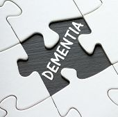 stock photo of missing  - The word DEMENTIA on a blackboard revealed by a missing jigsaw puzzle piece - JPG
