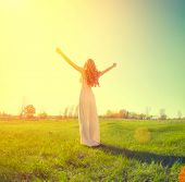 picture of grassland  - Beauty Girl enjoying nature on the field - JPG