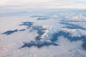 foto of andes  - Andes mountains cloudy from the sky - aerial view ** Note: Soft Focus at 100%, best at smaller sizes - JPG