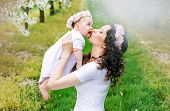 picture of vivacious  - Young mother and her little baby relaxing in a spring orchard - JPG