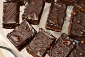 image of icing  - Cakes with chocolate icing in natural light - JPG