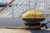 picture of bollard  - Old rusty mooring bollard at the pier - JPG