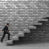 stock photo of climbing wall  - Concept or conceptual 3D man or  businessman climbing on a stair or steps near a wall background - JPG