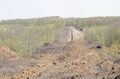 picture of loam  - A uncovered pipeline construction site with soil around - JPG