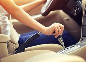stock photo of gear-shifter  - woman driver hand shifting the gear stick  - JPG