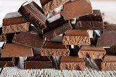 picture of food pyramid  - Pyramid of squared chocolate on wooden table - JPG