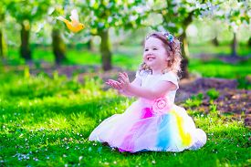 image of orchard  - Child playing with a bird - JPG