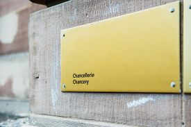 stock photo of corps  - Chancery chancellerie sign on building wall in front of diplomatic corps building - JPG