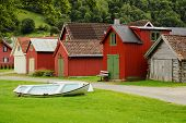 Coloured Wooden Buildings And The Boat