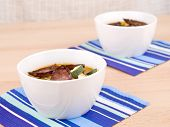 Two Bowls Of Tasty Homemade Spicy Soup poster