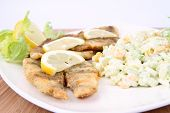 Fried fish with side salad
