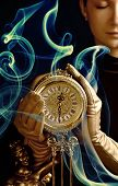 stock photo of pendulum clock  - Sepia picture of a beutiful girl with a clock  - JPG