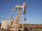 pic of nonrenewable  - Oil well in the desert with blue sky - JPG