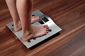 Woman feet on weight scale