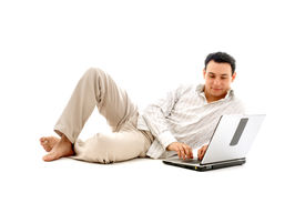 picture of self-employment  - relaxed man with laptop computer over white  - JPG