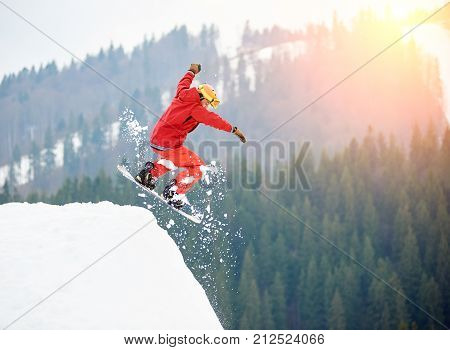 Male Snowboarder Freerider Jumping From