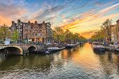 Amsterdam Sunset City Skyline At Canal Waterfront, Amsterdam, Netherlands poster