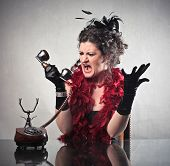 Furious elegant woman quarreling on the telephone