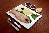 healthy food fresh roast red fish salmon with kale lemon antipesto ketchup sauce on white plate over poster
