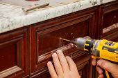 Master Drills The Door In The Cabinet Door poster