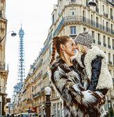 Mother And Daughter In Paris, France Looking At Each Other poster