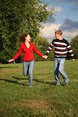 Attractive Couple Walking Outdoors Together poster