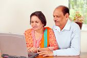 Mature indian couple on computer
