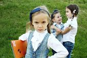 picture of peer-pressure  - Two little girls were whispering and laughing behind your back girlfriend - JPG