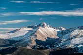High alpine tundra landscape with rocks and mountains at autumn. Rocky Mountain National Park in Col poster