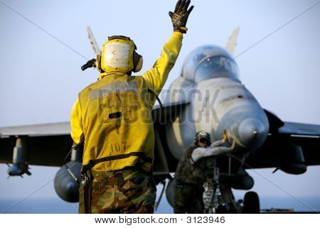 F18 Hornet And Sailors