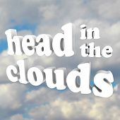 The words Head in the Clouds in 3D letters against a cloudy sky, representing someone who is mad, da