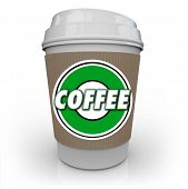 A cup of coffee from a store or restaurant with a holder sleeve and logo with the word Coffee on it